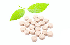 Pills with green leaf Stock Photos