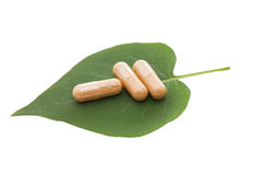 Pills on green sheet Royalty Free Stock Images