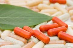 Pills on green sheet Royalty Free Stock Photos