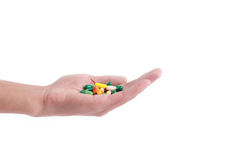 Pills in the hand. Some pills in the hand with white background stock photo