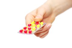Pills in hand stock images