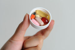 Pills on hand. Colorful pills on a girl's hand Royalty Free Stock Photos
