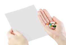 Pills in hand Stock Image