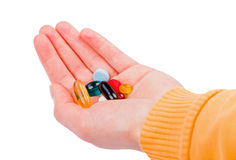Pills in hand Stock Photography