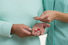 Pills in hand Royalty Free Stock Images