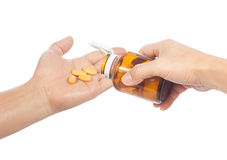 Pills in hand Stock Photo