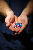 Pills in hand higher contrast Royalty Free Stock Images