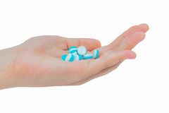 Pills on hand. Isolated on white background Stock Photos