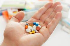 Pills on hand Stock Photography