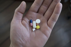 Pills on hand Stock Photos