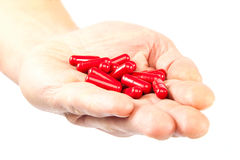 Pills in hand on white background. Royalty Free Stock Images