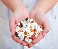 Pills in the hands Royalty Free Stock Photos