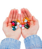 Pills in hands Stock Photography