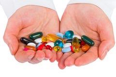 Pills in hands Stock Image