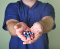 Pills in hands Royalty Free Stock Image