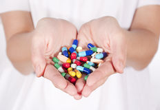 Pills in hands Stock Photos