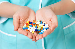 Pills in hands Royalty Free Stock Photo