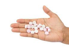 Pills in hands Stock Images