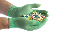 Pills on hands isolated on white background chemist pharmacy drug Stock Image