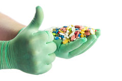 Pills on hands isolated on white background medicine Royalty Free Stock Images