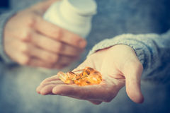 Pills. In hands. Medicine and health care concept. Toned image Royalty Free Stock Photography