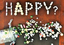 Pills and happiness Royalty Free Stock Photography