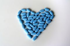 Pills For Health. Heart of blue pills Stock Photos