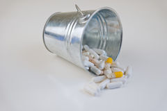 Pills for health in trash Royalty Free Stock Images