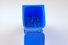 Pills for health in trash Royalty Free Stock Photos
