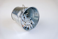 Pills for health in trash Stock Photo