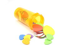 Pills for the heart. Foam hearts spilling out of a medication pill bottle Stock Images