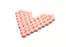 Pills in heart shape Royalty Free Stock Images