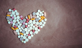 Pills heart top view. Royalty Free Stock Photography