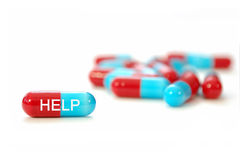 Pills, help. Closeup of a pill with the word help Stock Images