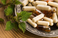 Pills with herbs, macro Royalty Free Stock Photography