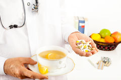 Pills and hot tea for colds and flu. Stock Photo