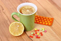 Pills and hot tea with lemon for colds, treatment of flu and runny Stock Images