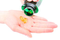Medicinska pills i en räcka hällde från en buteljera Royaltyfri Foto
