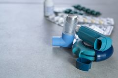 Pills and inhalers for asthma, bronchitis, lungs diseases. First aid Royalty Free Stock Photo