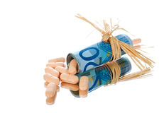 Pills inside money. Studio shoot of pills inside euro money Stock Photo