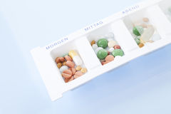 Pills inside pill box, elevated view Royalty Free Stock Photos