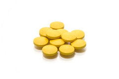 Pills isolated. Yellow pills on a white background Stock Photography