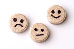 Pills of joy, sadness and indifference. On white background close-up Royalty Free Stock Image