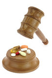 Pills and law Royalty Free Stock Photography