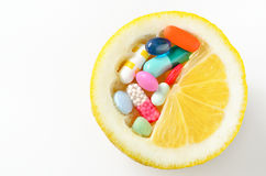Pills and lemon  isolated Stock Images
