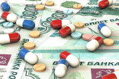 Pills lie on the background of rouble money. Medical business concept. Stock Photo