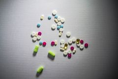 Assorted pharmaceutical medicine pills, tablets and capsules.Pills background. Heap of assorted various medicine tablets royalty free stock photos