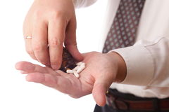 Pills in man hand. Man with pill - blue white pills in man hand isolated Royalty Free Stock Photos