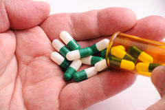 Pills in Man's Hand royalty free stock images
