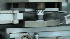 Pills manufacturing machine at pharmaceutics factory
